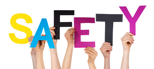 Many Caucasian People And Hands Holding Colorful  Letters Or Characters Building The Isolated English Word Safety On White Background